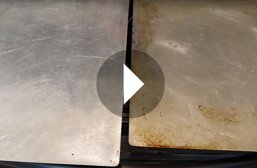 Still shot of video with one baking sheet cleaned and one sheet dirty