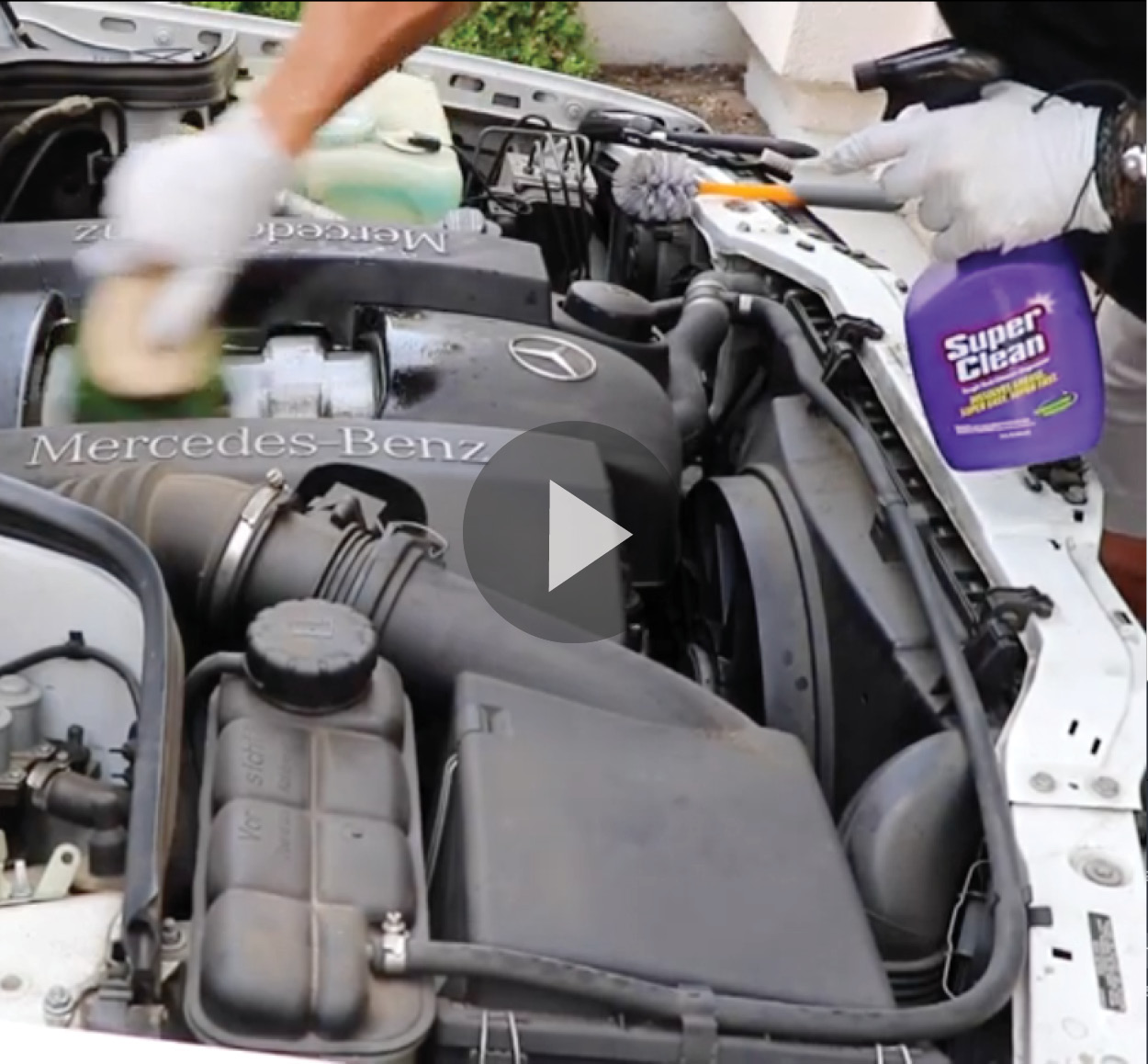 Car engine being degreased with Super Clean